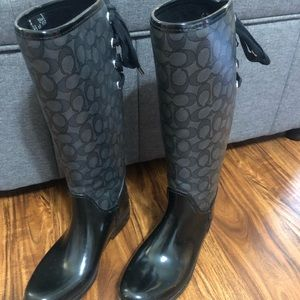 Ladies size 9 black Coach tall rain boots with tie